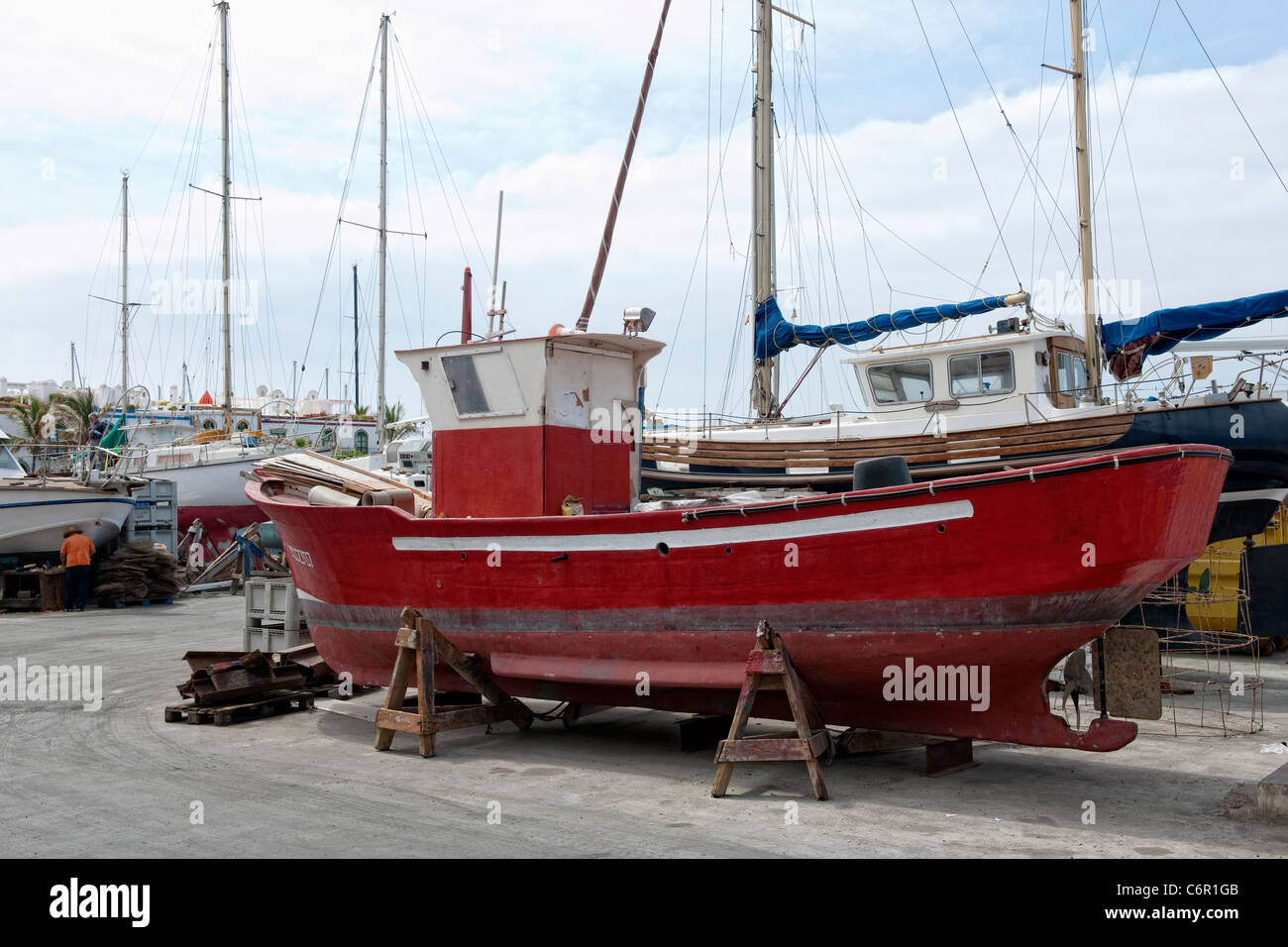 Boat being repaired in the dry dock in Puerto Mogan on Gran Canaria - Stock Image