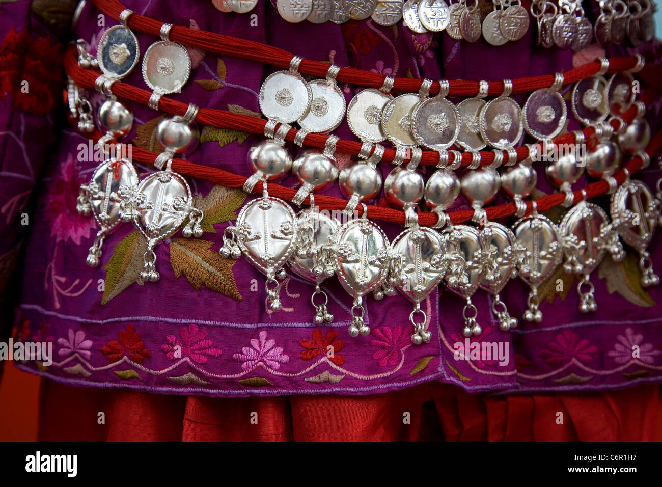 Silver bells belted around Indian Costume - Stock Image