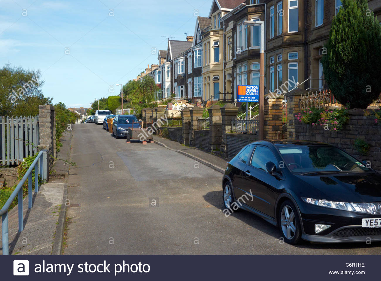 row of victorian terraced houses in welsh town of port talbot wales - Stock Image