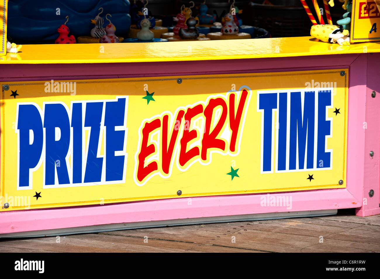 Sign proclaiming 'Prize Every Time' at an amusement arcade on Llandudno Pier - Stock Image