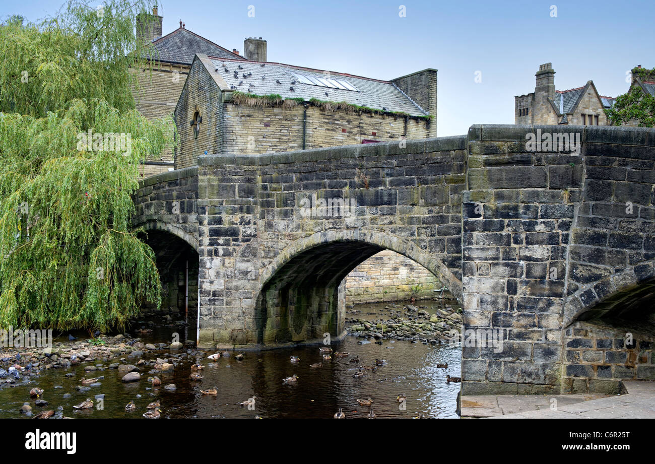 The famous stone bridge spanning the River Hebden in Hebden Bridge, West Yorkshire - Stock Image