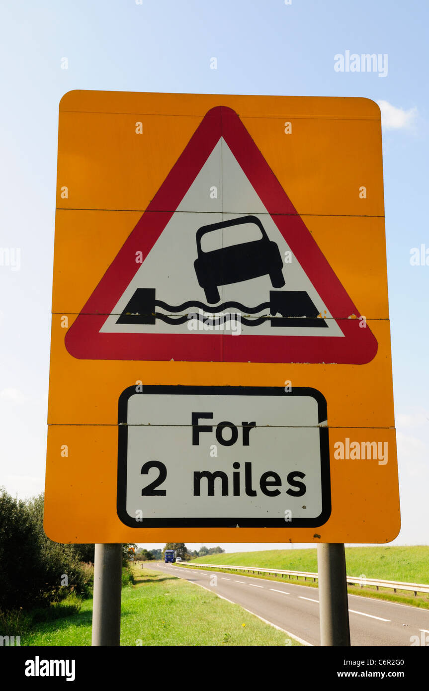 Water Course Alongside Road for 2 Miles Road Sign, Ten Mile Bank, near Littleport, Cambridgeshire, England, UK - Stock Image
