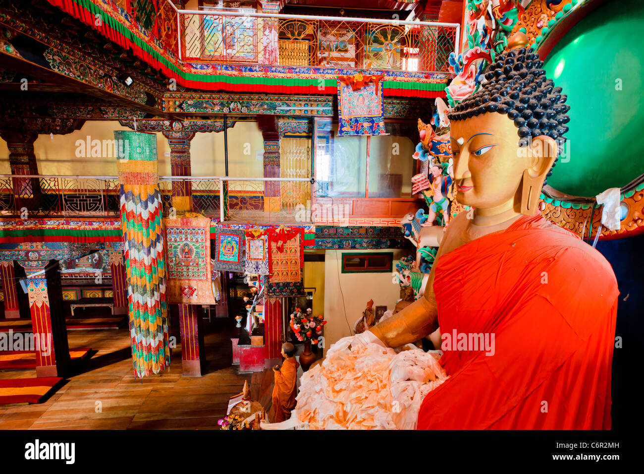 Multi colored embroidered hangings in the interior of Tawang Gompa Arunachal Pradesh, India - Stock Image