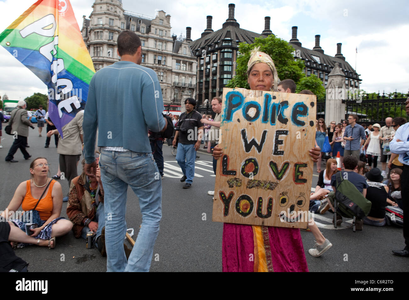 Democracy Village campers hold a peaceful sit-down protest outside the Houses of Parliament. - Stock Image