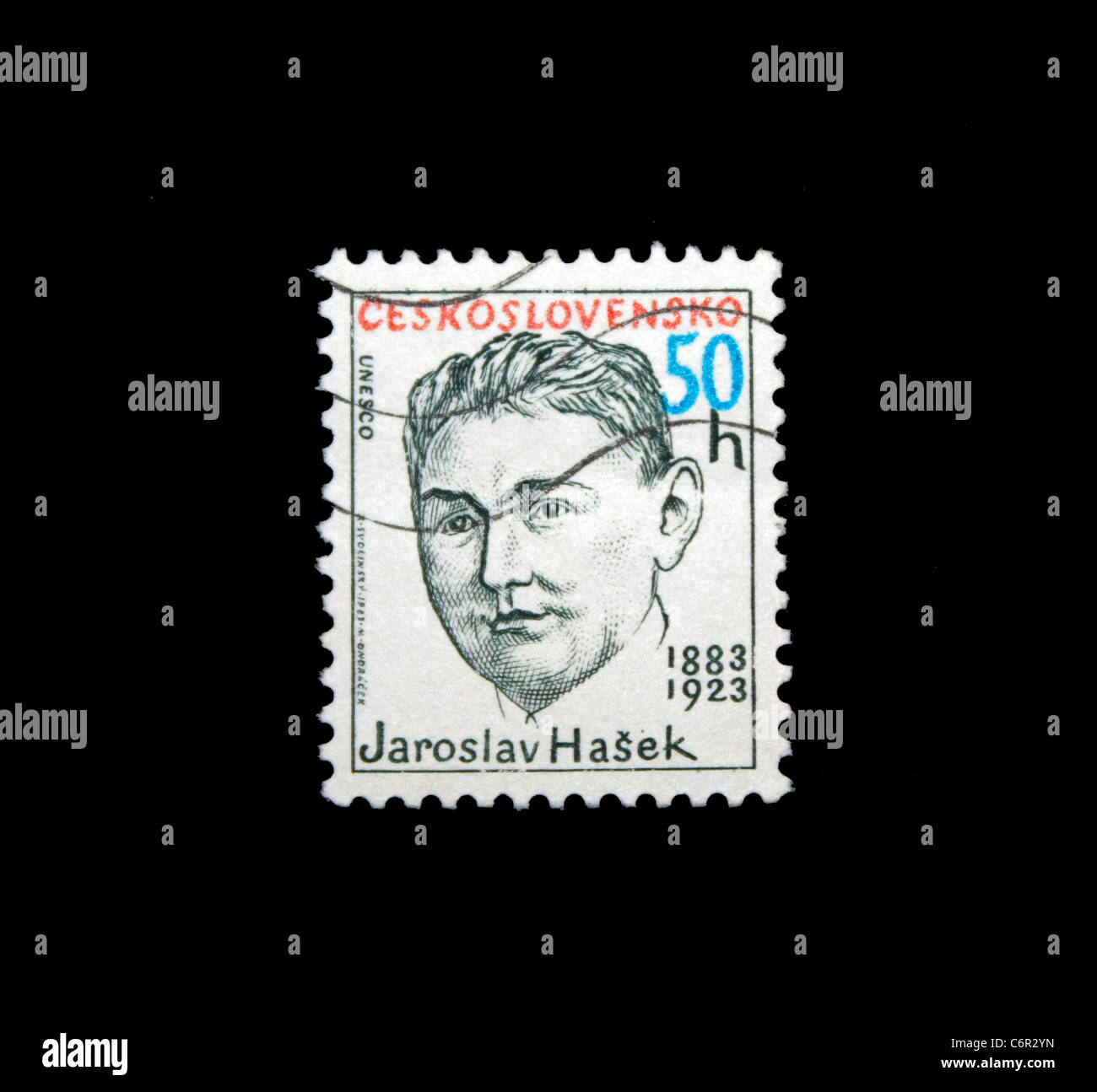 A Postage stamp isolated in black Stock Photo