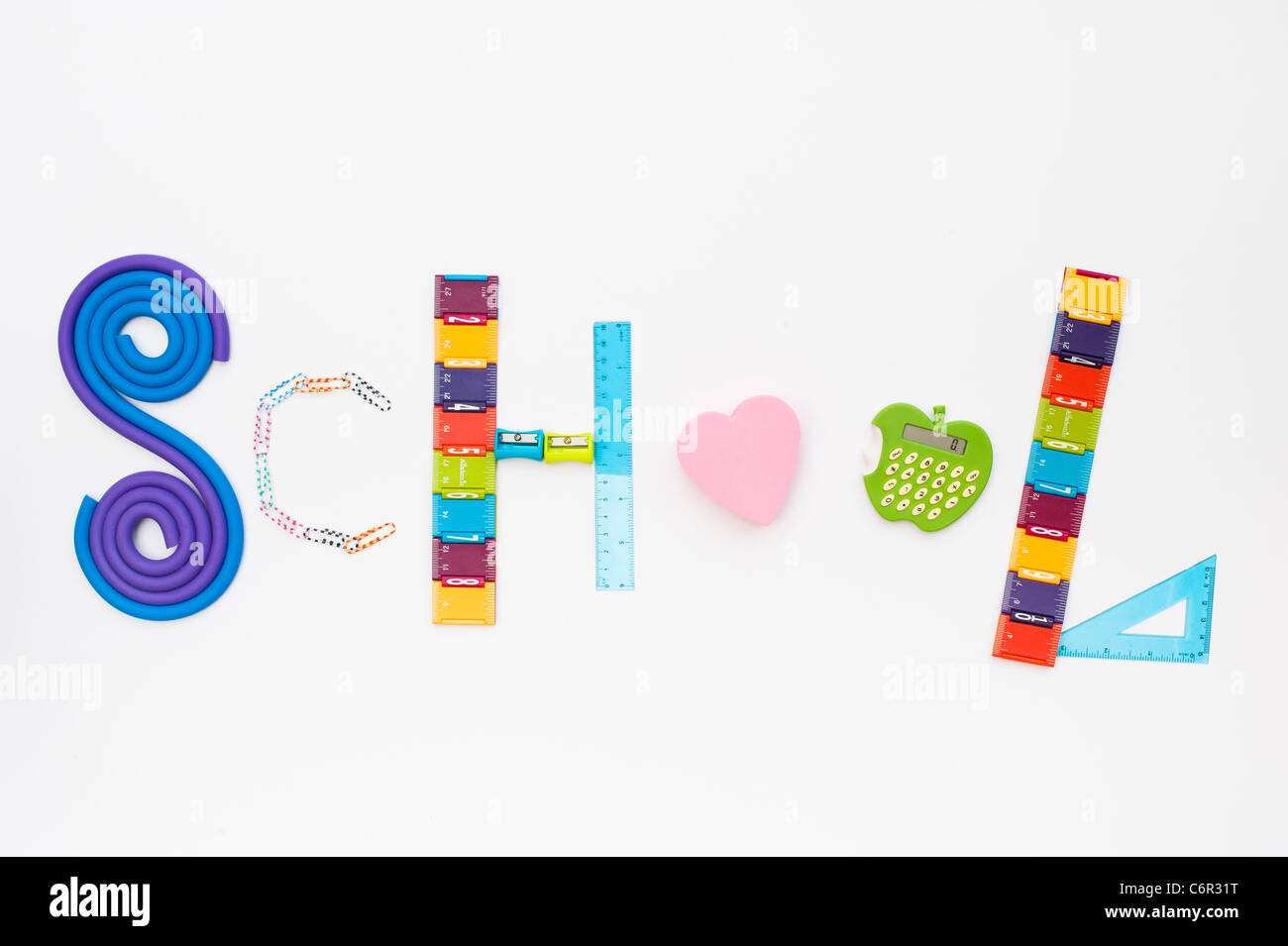 Word School using childrens school stationary on white background - Stock Image