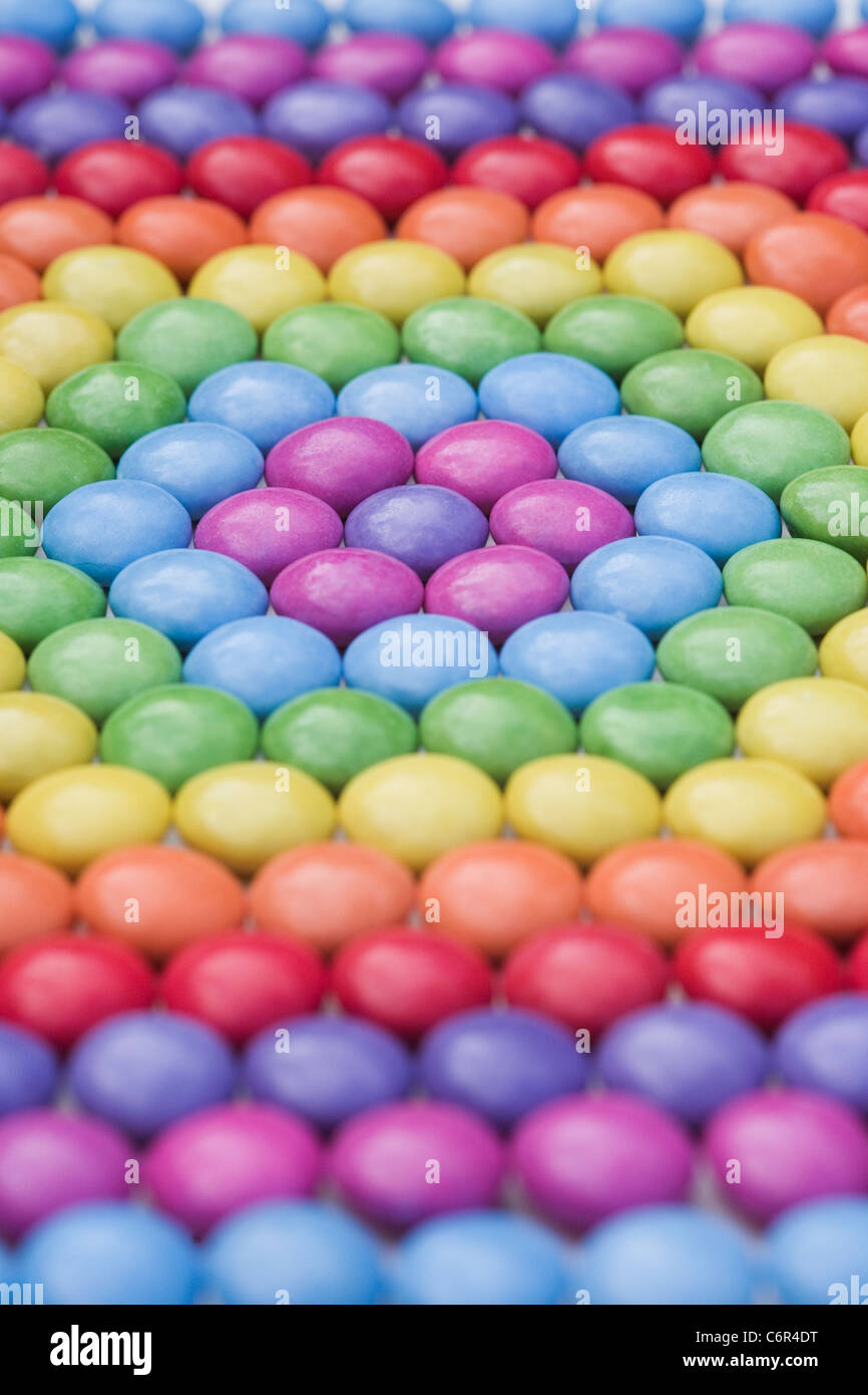 Hexagon shaped smartie pattern. Close up. - Stock Image