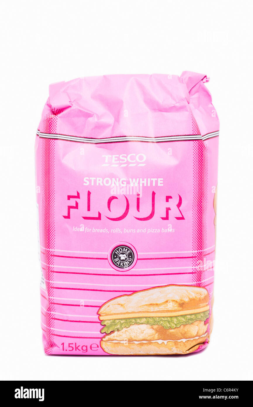 A packet of Tesco strong white flour for baking on a white background - Stock Image