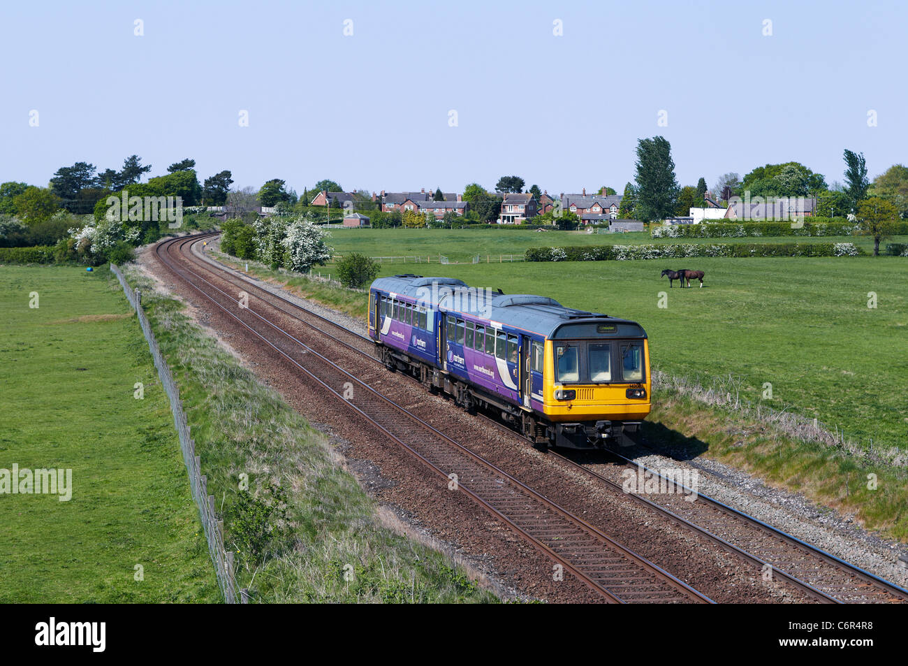 142087 heads the 14:17 Manchester Piccadilly - Chester Northern Rail through Ashley (Cheshire) on 30/04/11. - Stock Image