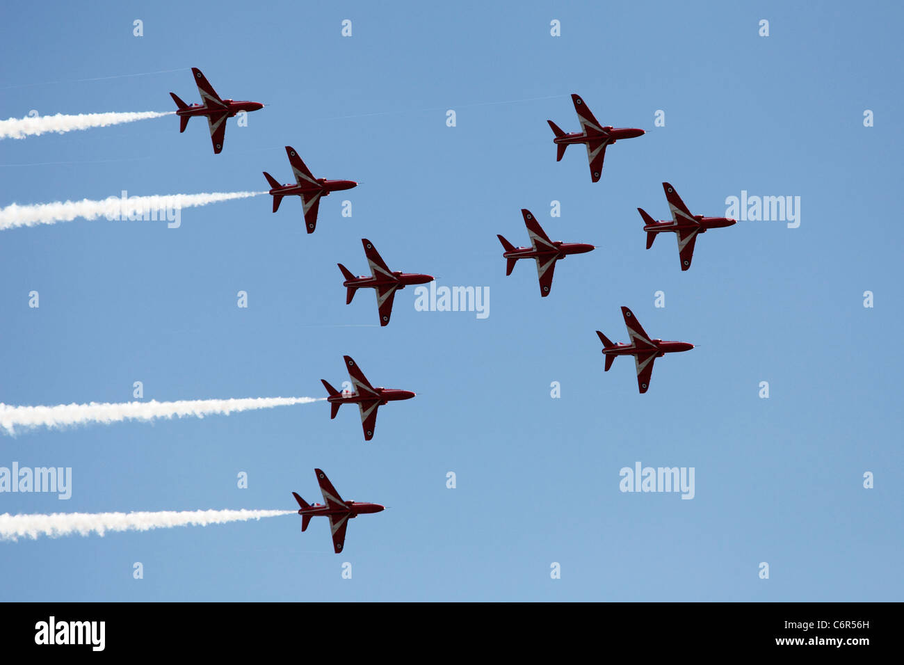 'Red Arrows' Hawk T1 jets flying in Viggen formation against blue sky, England, UK - Stock Image
