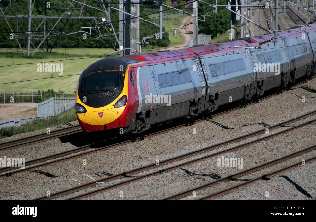 Virgin Tilting Pendolino passenger train on the West Coast Mainline in June 2011. Stock Photo