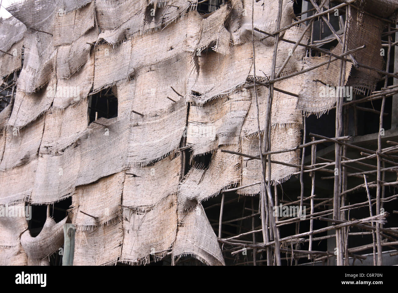 Construction scaffolding and screens on a multi-storey building in downtown Awassa - Stock Image