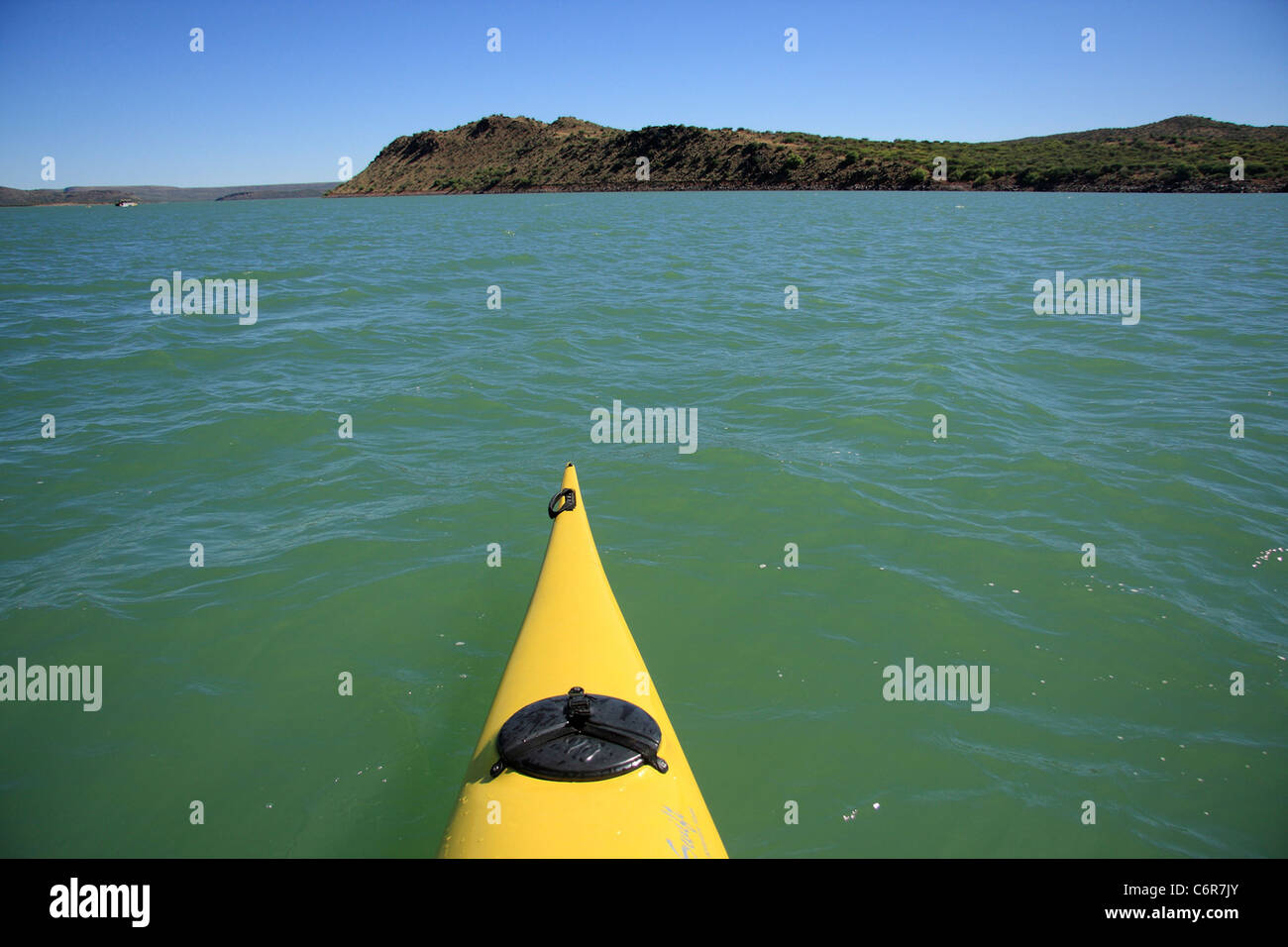 View from a yellow kayak on Van Der Kloof Dam - Stock Image