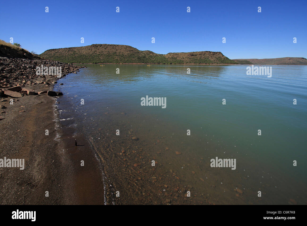 View from the shore over Van Der Kloof Dam - Stock Image