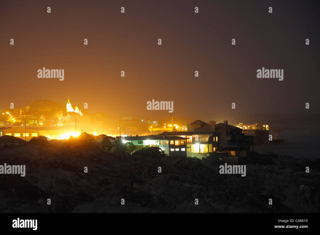 View over Luderitz lit up at night - Stock Image