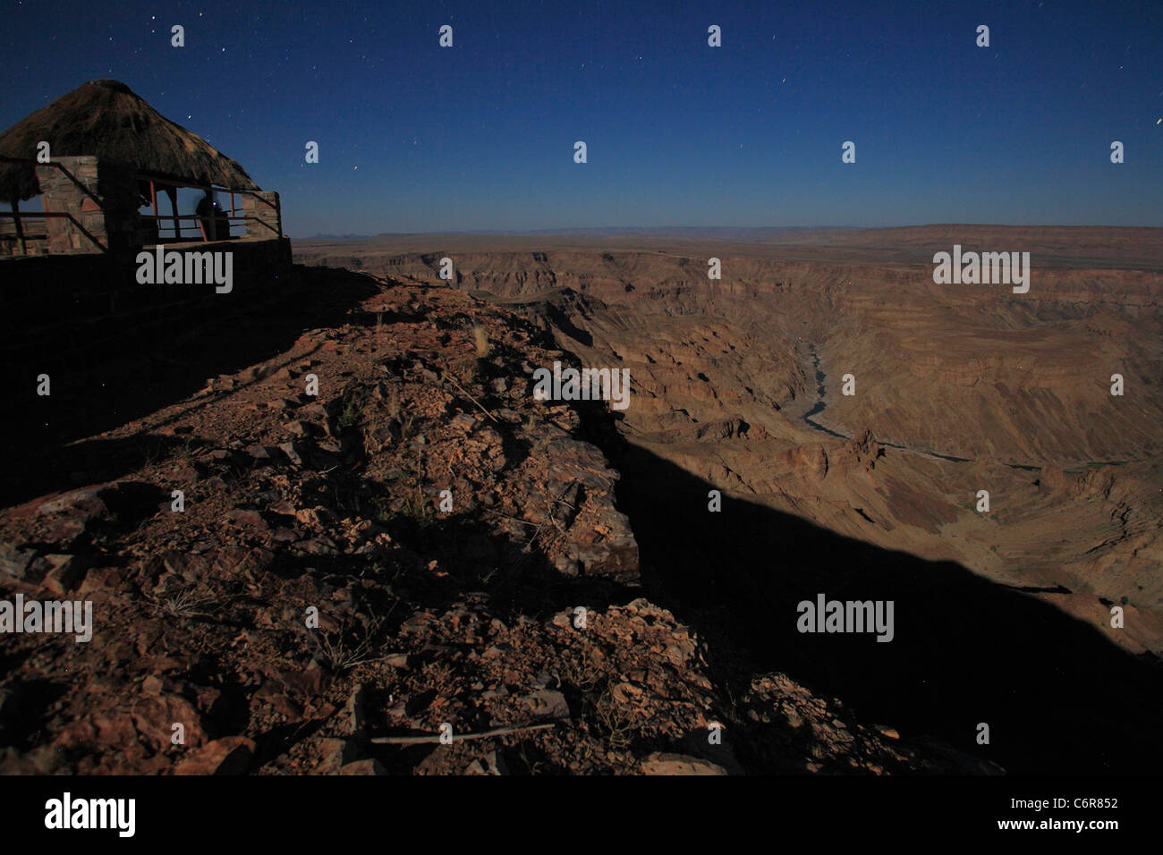 Hikers at look-out point overlooking Fish River Canyon - Stock Image
