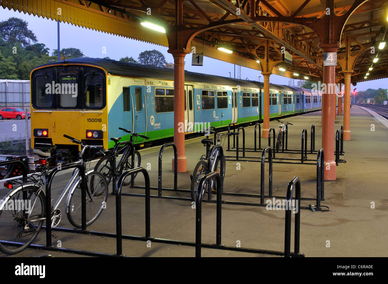 Network West Midlands trains at Leamington Spa railway station, early morning, Warwickshire, England, UK - Stock Image