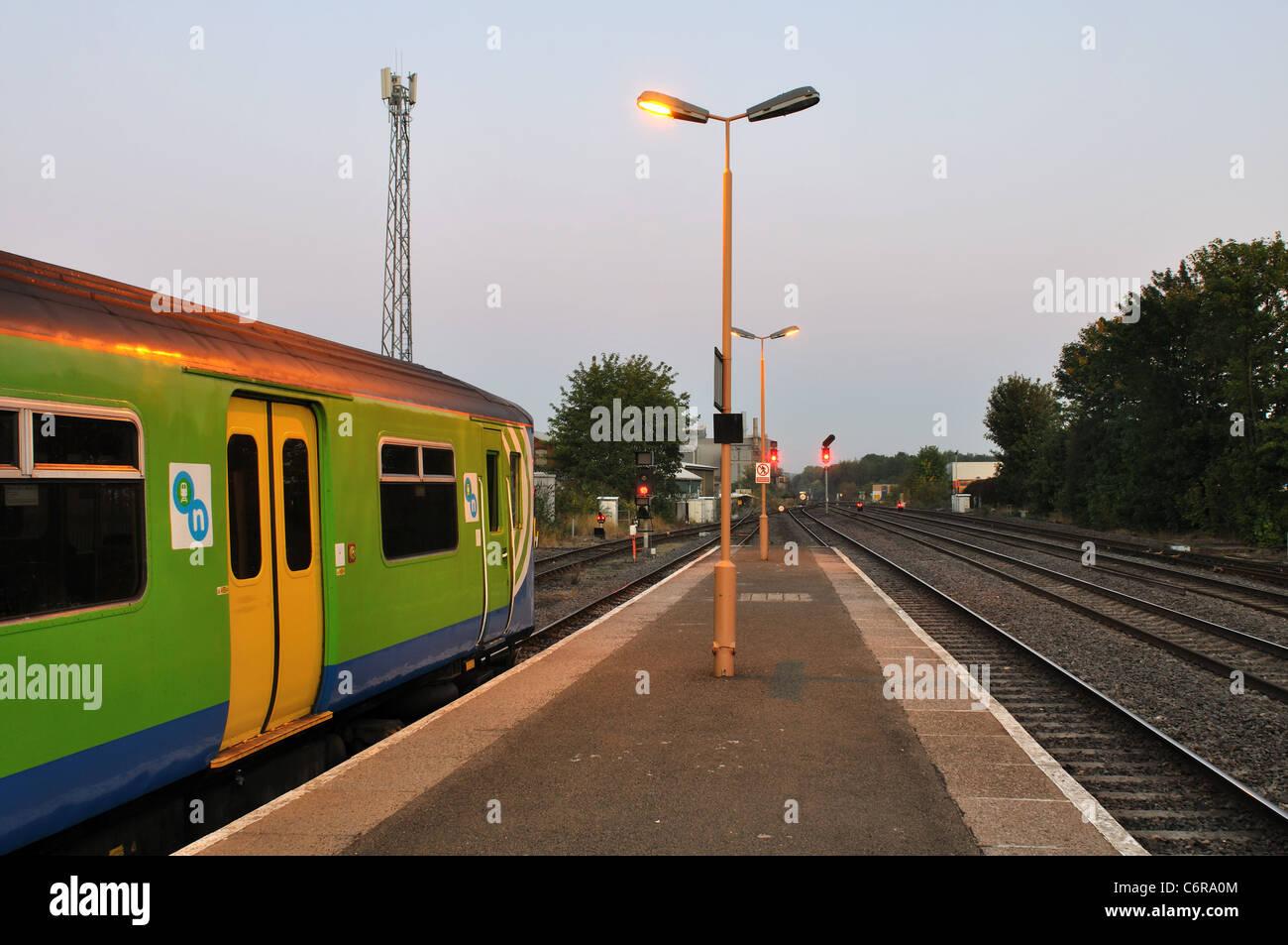 Network West Midlands train at Leamington Spa railway station, early morning, Warwickshire, England, UK - Stock Image