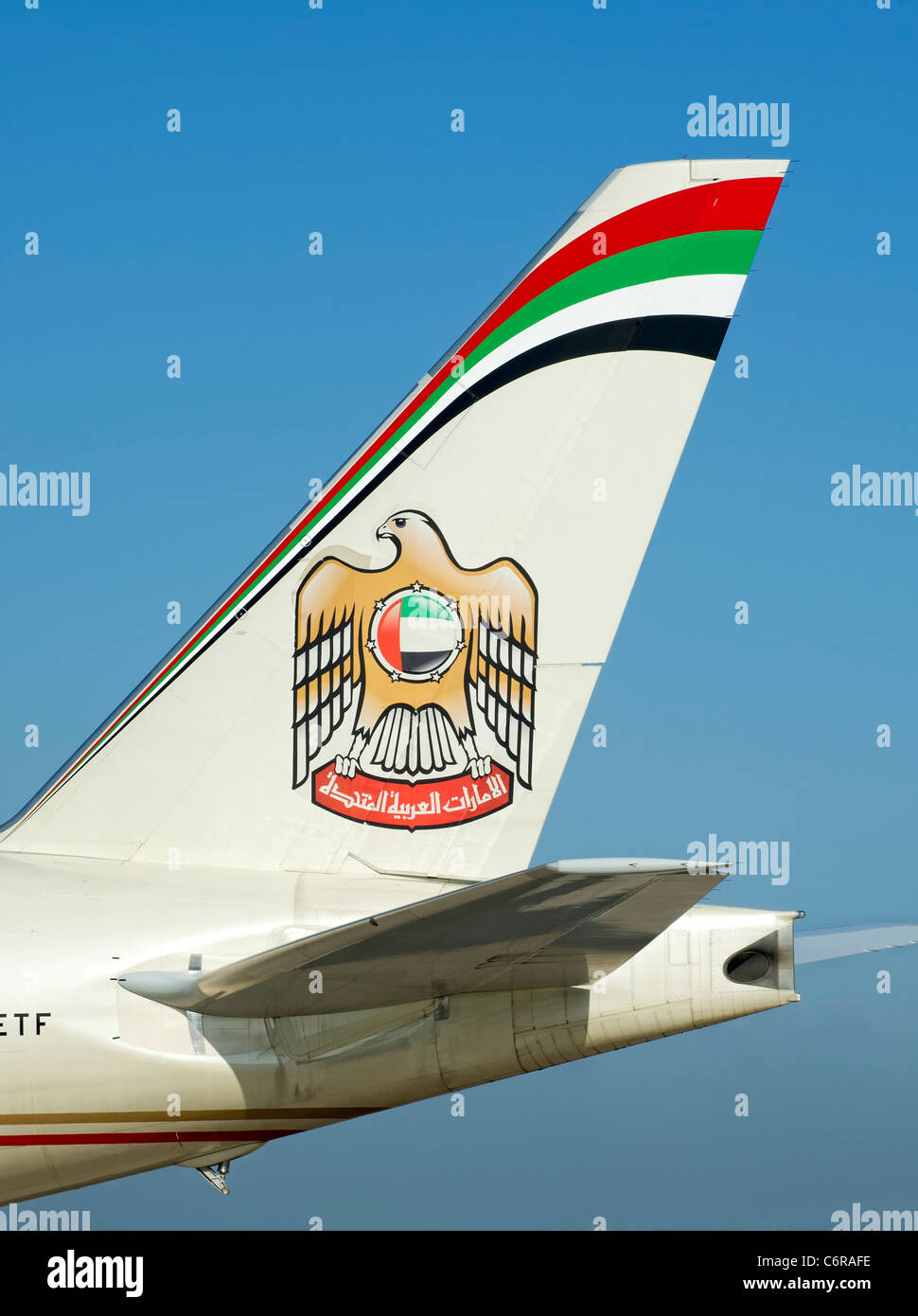 Tail fin of an Etihad aircraft showing the logo - Stock Image