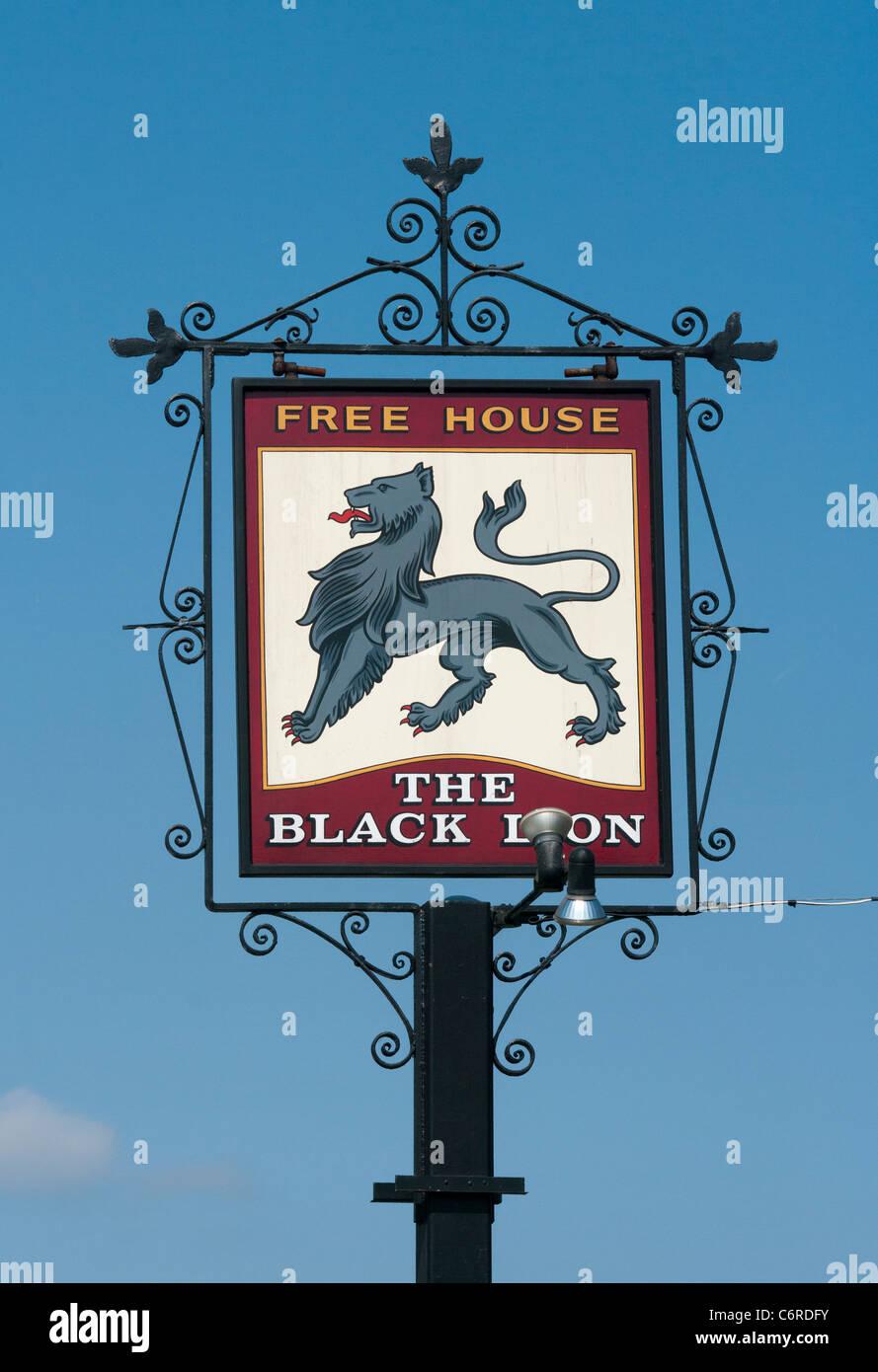 The Black Lion Free House Pub Sign UK Pub Signs - Stock Image