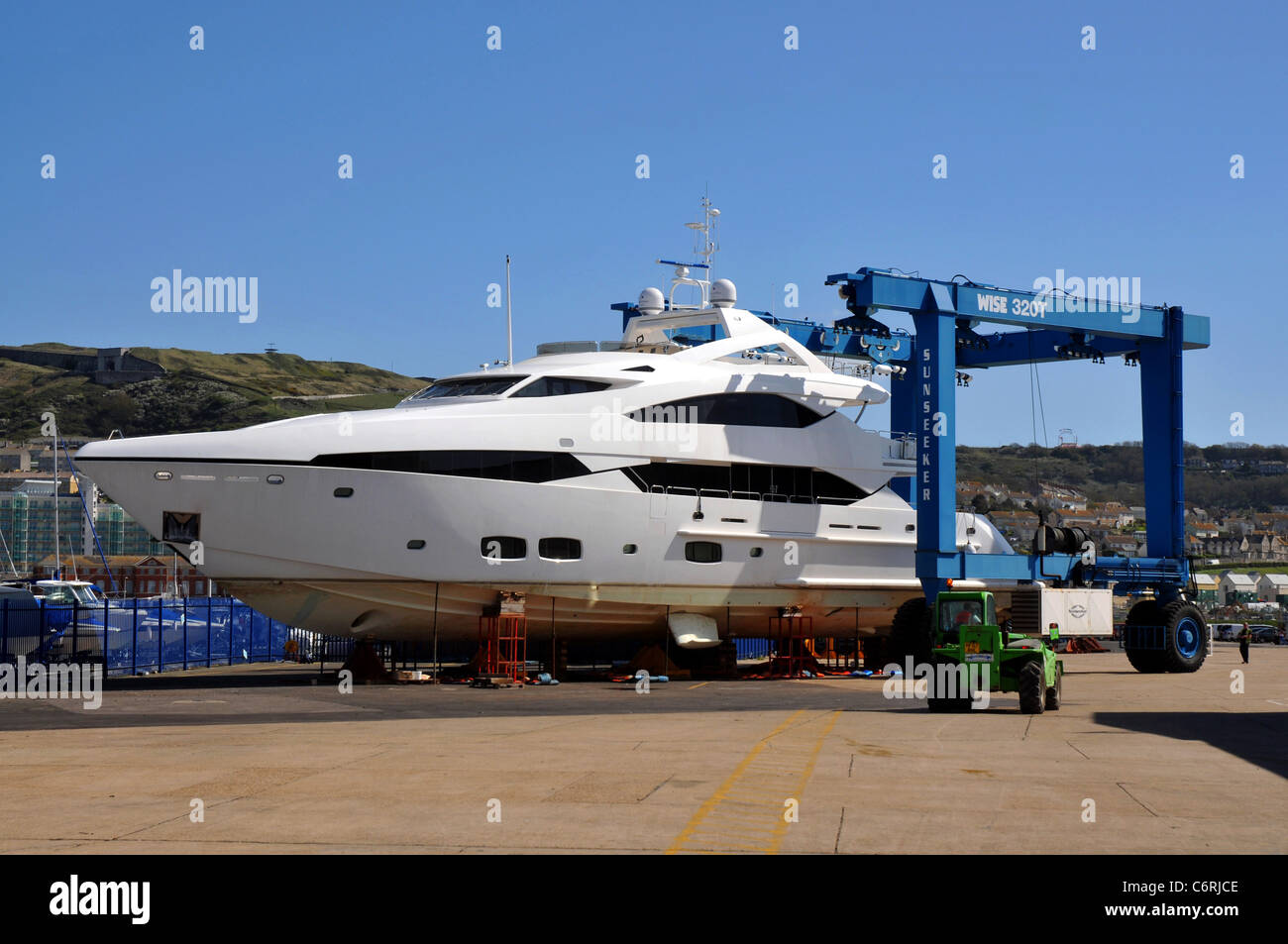 Sunseeker luxury yacht being moved in a 50 Tonne cradle at Portland in Dorset. UK - Stock Image