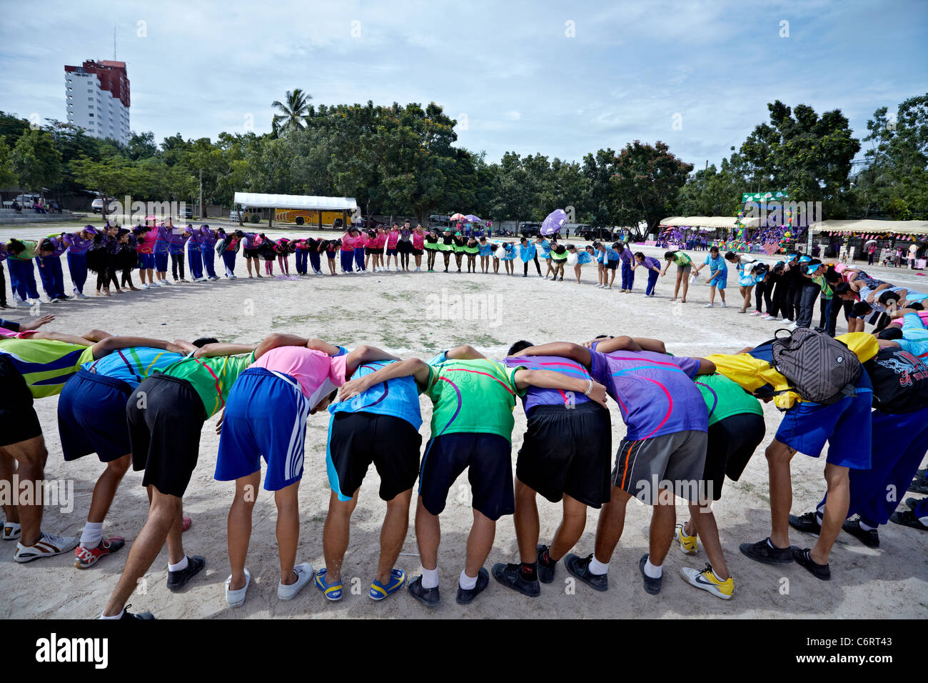 Circle of friendship and gesture of camaraderie by competing local teams at the culmination of an Asian school sports - Stock Image