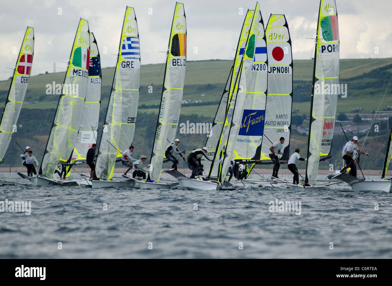 Sailors competing in the  London Olympic 2012 trial regatta in Weymouth and Portland - Stock Image