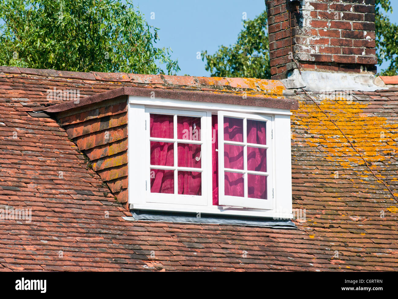 A House Roof Loft Dormer Window - Stock Image