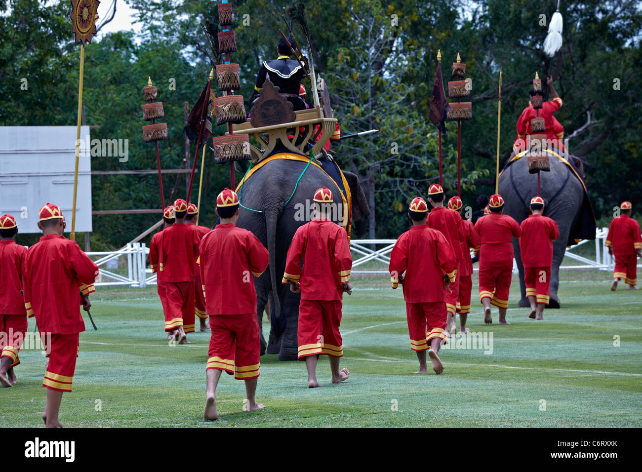 Procession of people in traditional Thai dress at the 10th Kings Cup elephant polo festival. Hua Hin Thailand Asia. - Stock Image