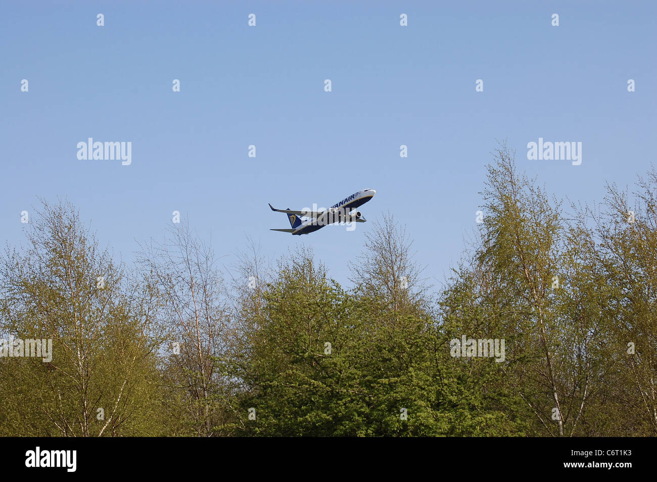 Ryanair twin jet passenger aircraft climbing out from airport - Stock Image