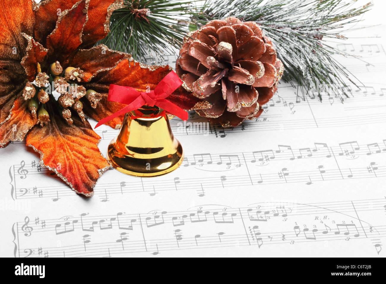 Christmas Ornaments and Sheet Music - Stock Image