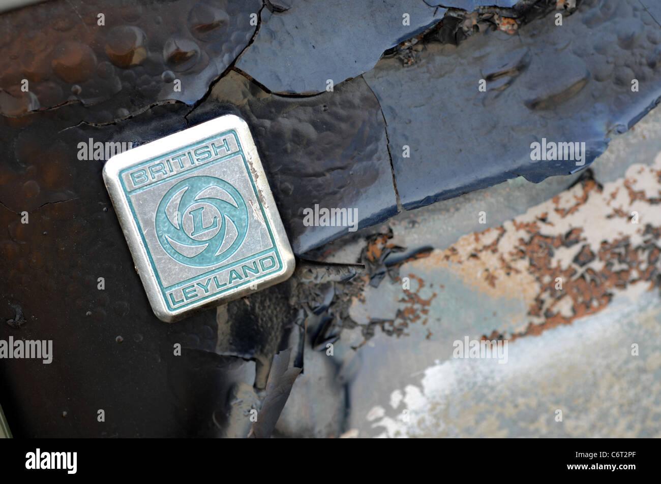 British Leyland badge on a rusty burnt vehicle - Stock Image