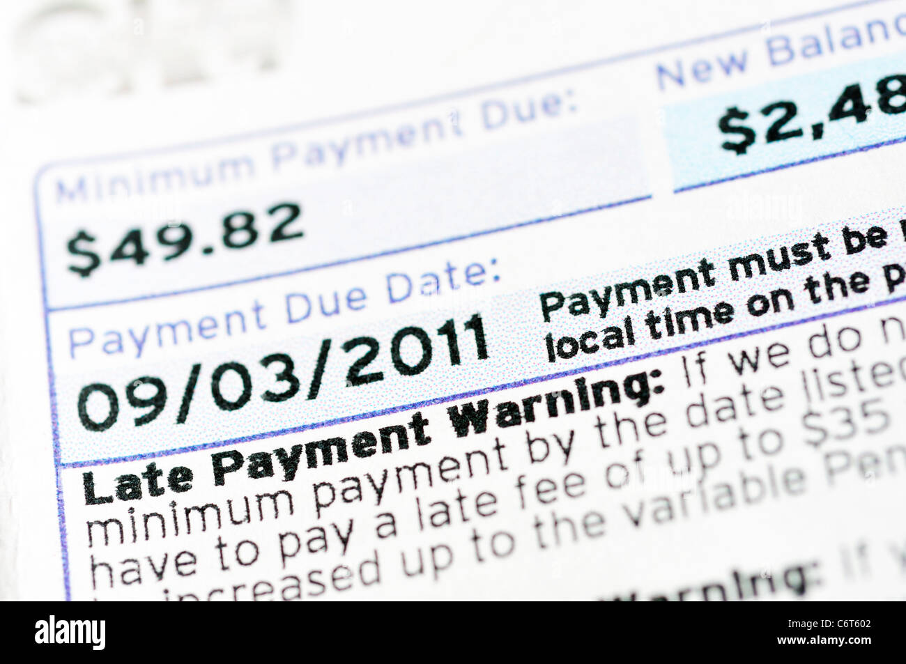 Credit card bill statement and late payment warning Stock Photo