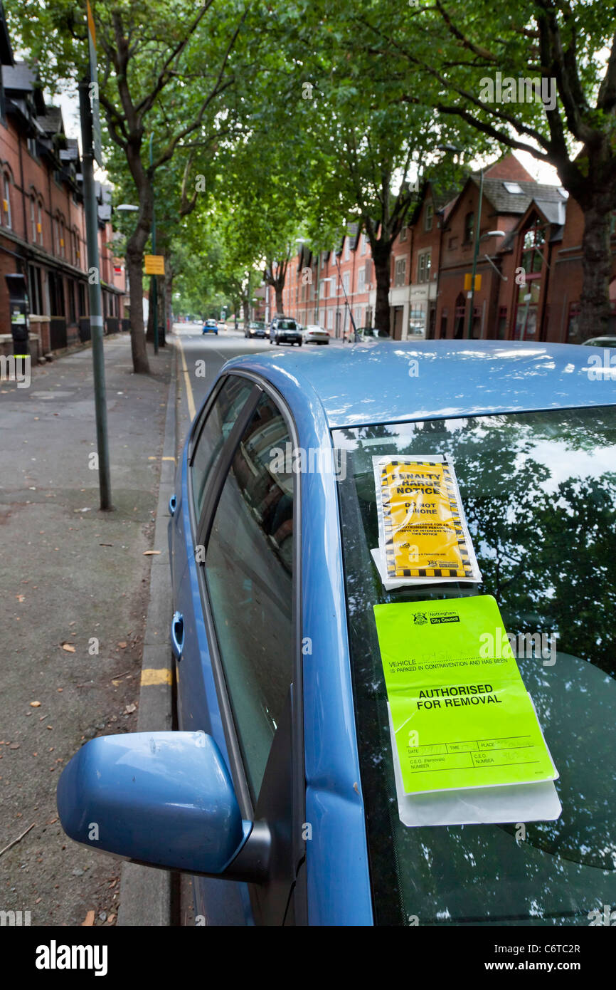 Parking ticket on a blue car nottingham england uk gb eu europe - Stock Image
