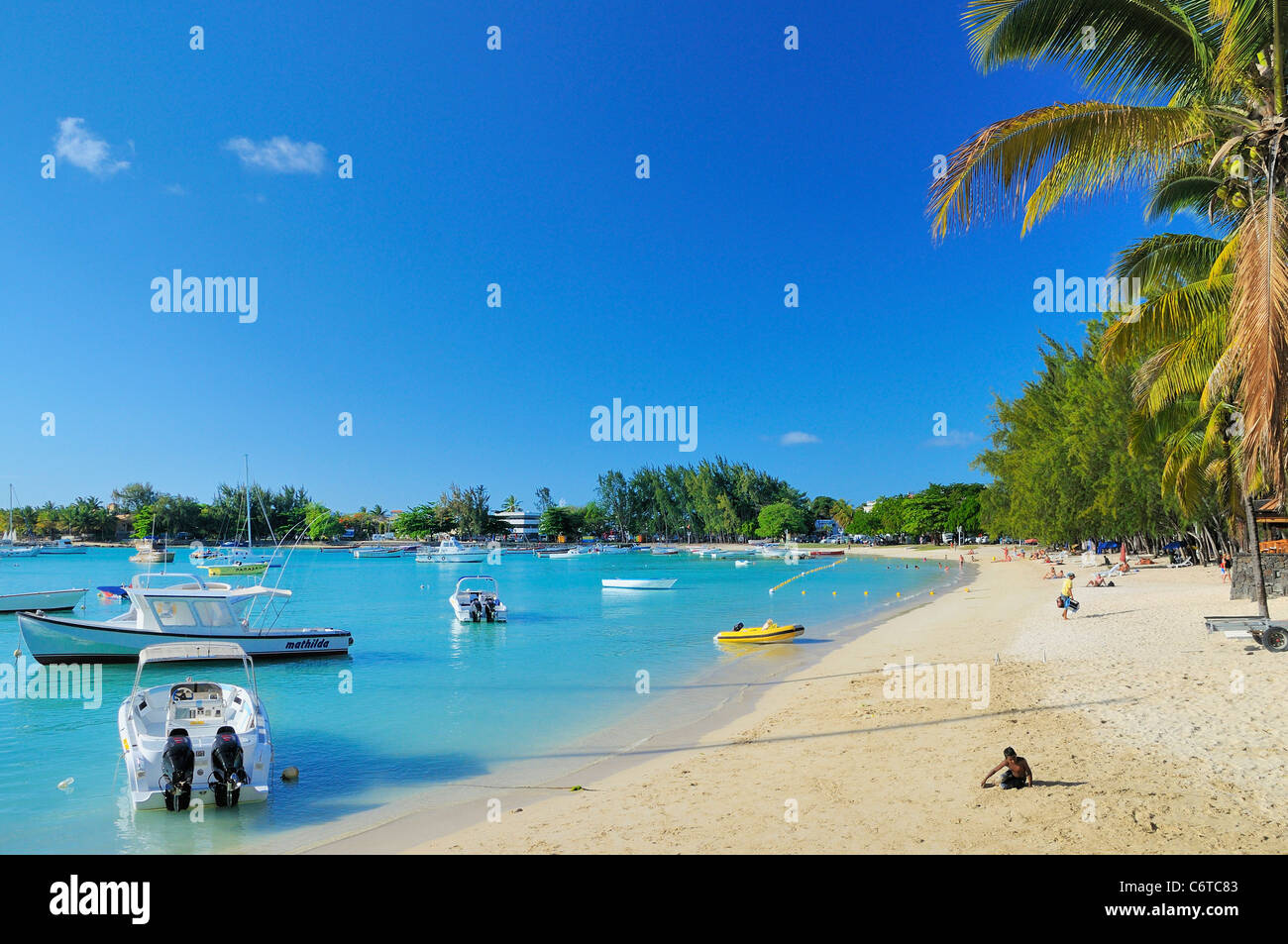 The beach and bay in Grand Baie, Riviere Du Rempart, Mauritius - Stock Image