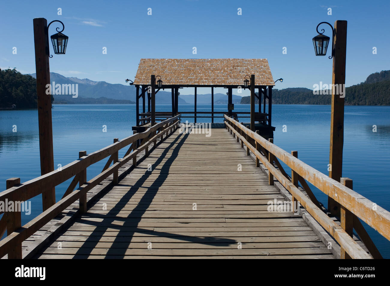 Nahuel Huapi Lake in Argentina on a day of faultless blue sky and matching flat calm blue water seen over a deserted - Stock Image
