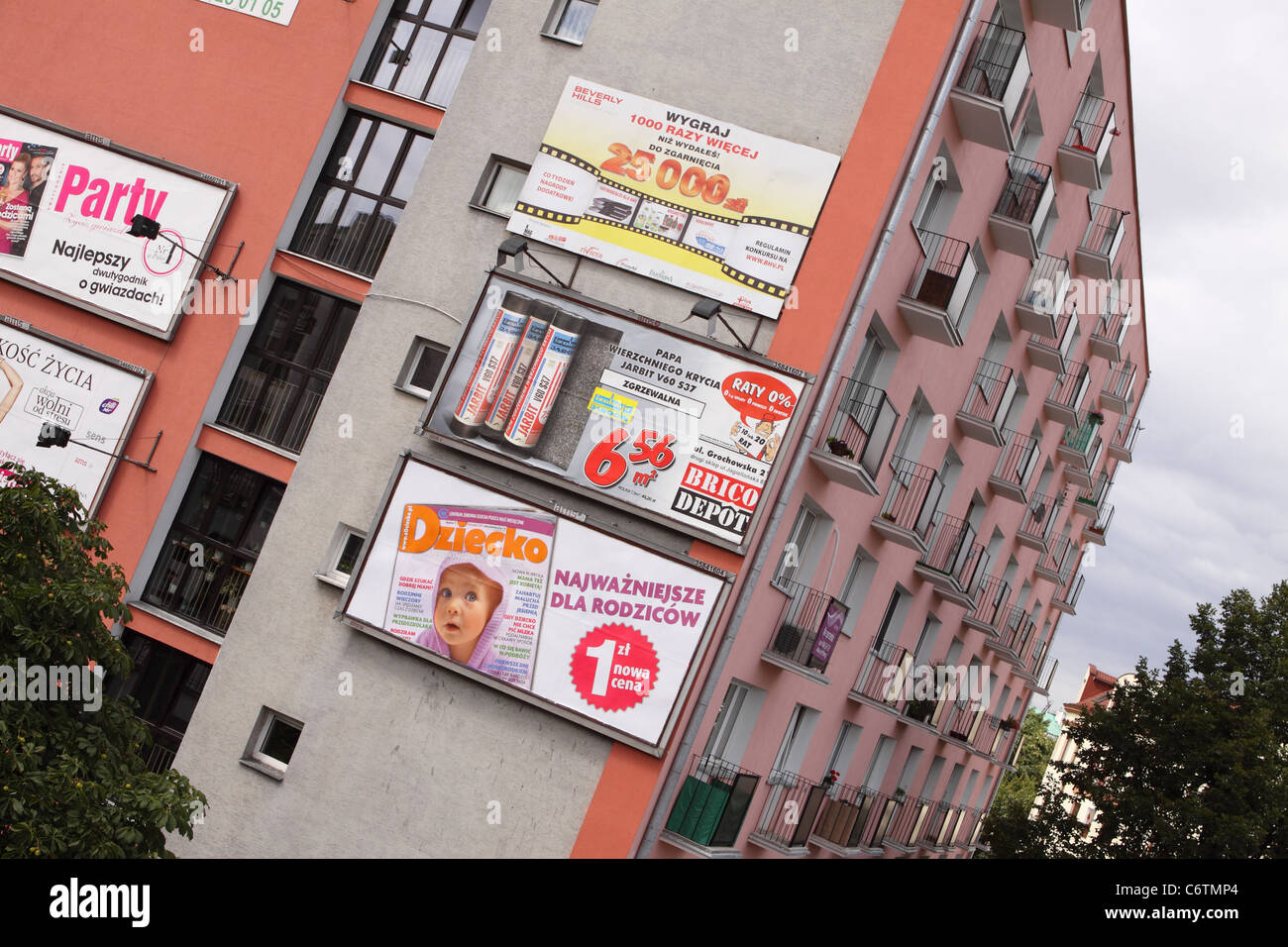 Warsaw Poland large billboard adverts advertising on the side of a block of flats - Stock Image
