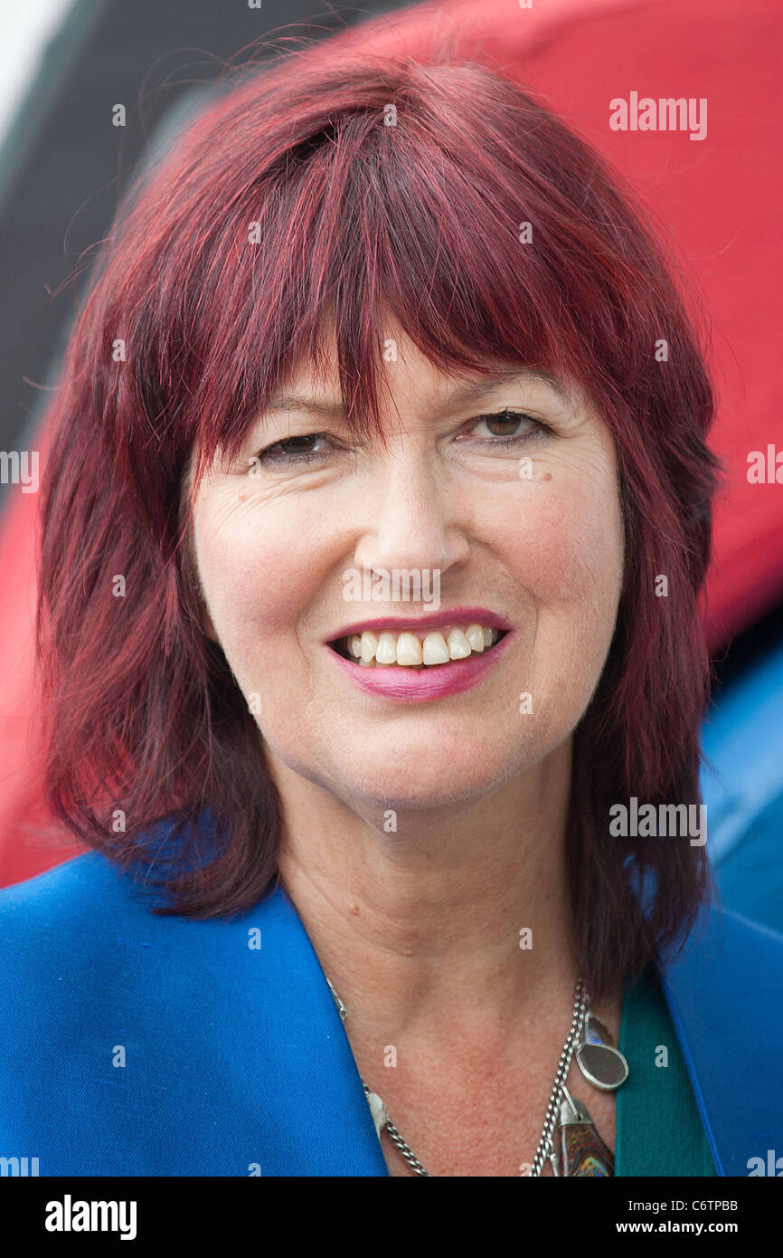 Janet Street Porter cutting a giant Tractor cake to celebrate 10 years of Great Food and Great Farming under the - Stock Image