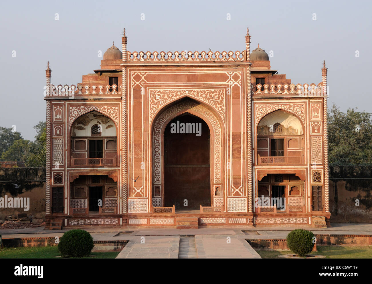 Red sandstone building with inlaid white marble in the grounds of the Tomb of Itimad ud Daulah whose name was Mirza Stock Photo