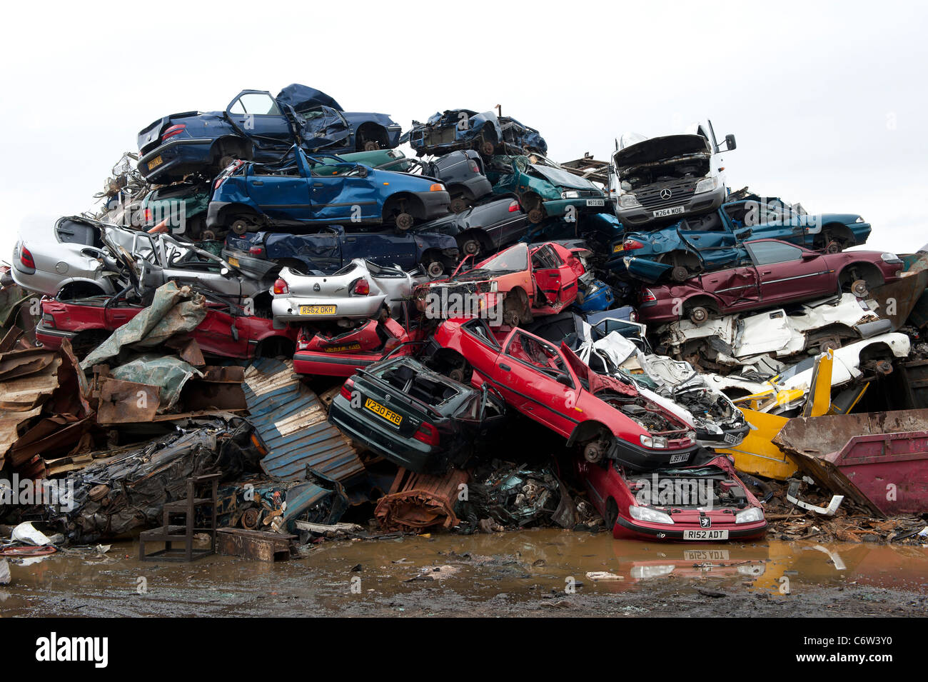 Scrap cars in a scrap metal yard which will be crushed and recycled ...