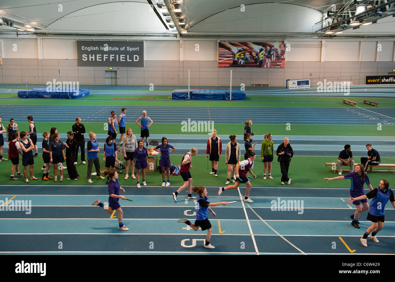 Secondary school children compete in a relay race at the English Institute of Sport in Sheffield, UK - Stock Image