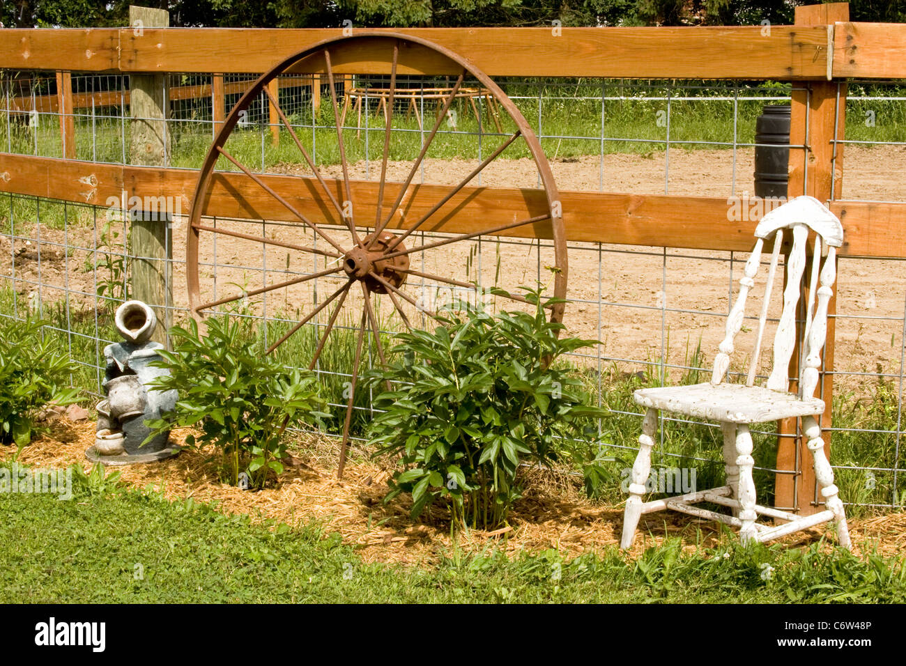 Vintage Steel Wagon Wheel Against A Wooden Fence Stock Photo Alamy