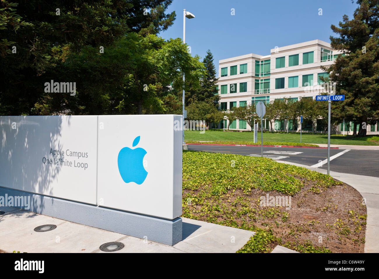 Apple logo outside Apple Incorporated's corporate headquarters at 1-6 Infinite Loop, Cupertino, California, - Stock Image