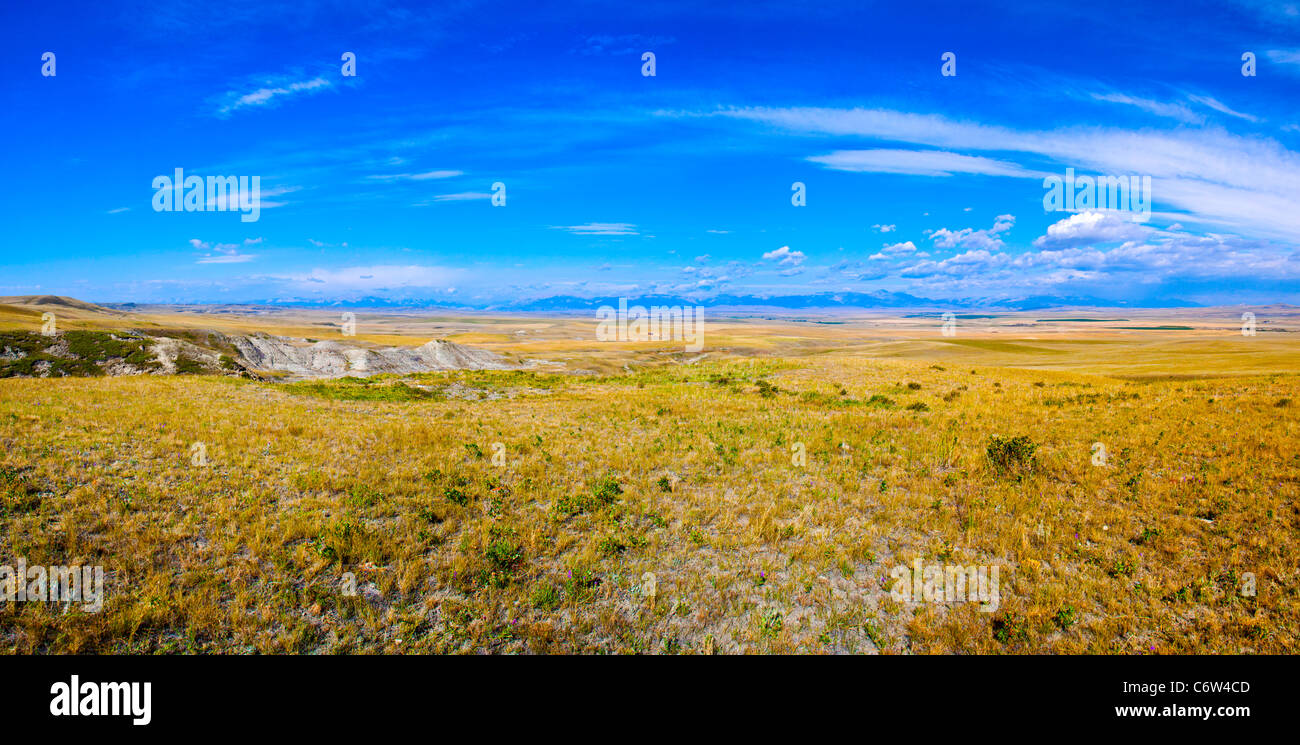 """Panorama of roadside scene in Montana, with farming and ranching and """"Big Sky"""" views. Stock Photo"""