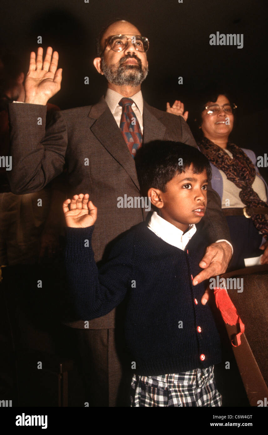 A south asian family is takes the oath of citizenship during an immigration naturalization ceremony - Stock Image