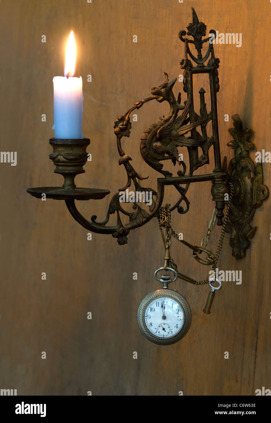 piano candlestick burning at midnight - Stock Image