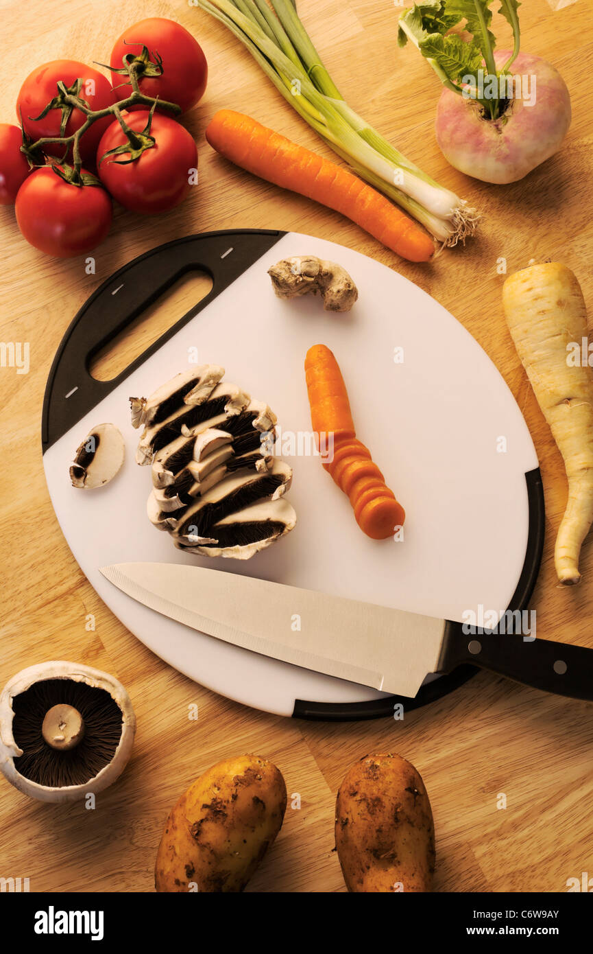 Plastic Cutting Board With Vegetables & Knife - Stock Image