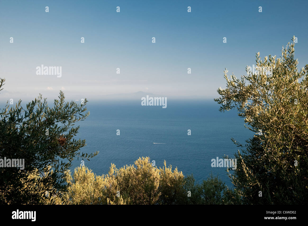 View from above Amalfi, Italy, looking over the Tyrrhenian Sea towards the distant mountains of Sicily - Stock Image