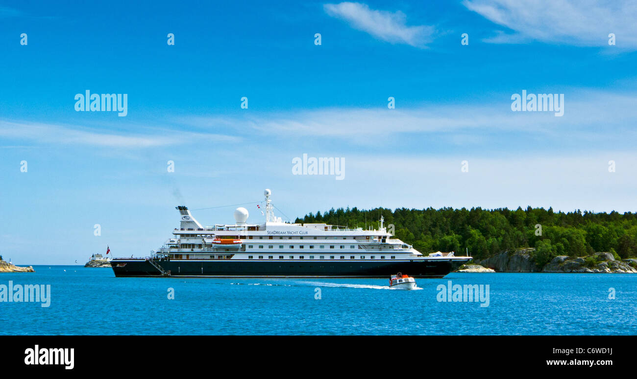 An exotic cruise ship Seadream anchored in Lillesand, Norway - Stock Image