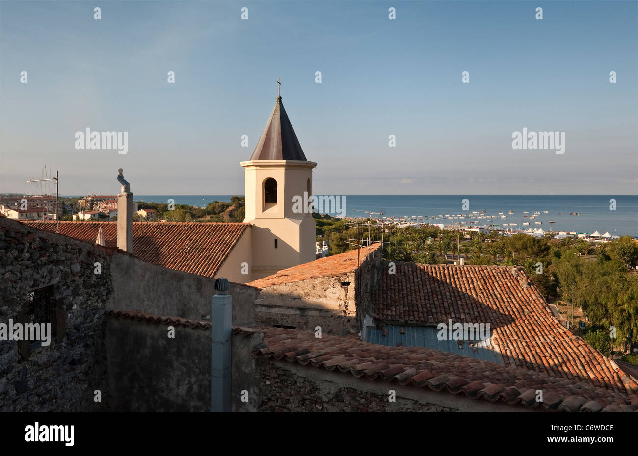 Scalea, Calabria, Italy. View over the tiled roofs of the old town towards the sea - Stock Image